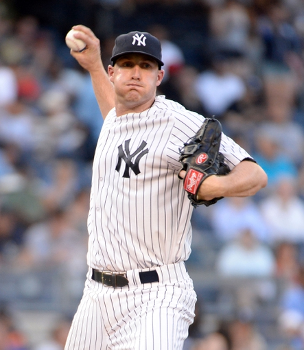 Jun 18, 2014; Bronx, NY, USA; New York Yankees starting pitcher Chase Whitley throws to first base against the Toronto Blue Jays in the first inning during the MLB baseball game at Yankee Stadium. Mandatory Credit: Robert Deutsch-USA TODAY Sports