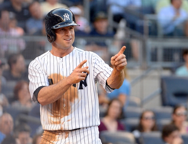 Jun 18, 2014; Bronx, NY, USA; New York Yankees left fielder Brett Gardner reacts after scoring a run on a single hit by teammate Alfonso Soriano (not pictured) in the first inning against the Toronto Blue Jays during the MLB baseball game at Yankee Stadium. Mandatory Credit: Robert Deutsch-USA TODAY Sports