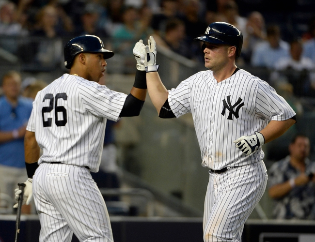 Jun 18, 2014; Bronx, NY, USA; New York Yankees catcher Brian McCann (right) celebrates with teammate Yangervis Solarte (26) after hitting a two-run home run in the 4th inning against the Toronto Blue Jays during the MLB baseball game at Yankee Stadium. Mandatory Credit: Robert Deutsch-USA TODAY Sports