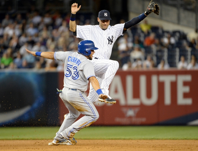 Jun 18, 2014; Bronx, NY, USA; Toronto Blue Jays left fielder Melky Cabrera (53) reacts after being forced out by New York Yankees shortstop Derek Jeter (right) in the 5th inning during the MLB baseball game at Yankee Stadium. Mandatory Credit: Robert Deutsch-USA TODAY Sports