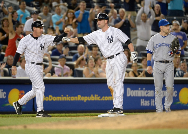 Jun 18, 2014; Bronx, NY, USA; New York Yankees catcher Brian McCann (middle) is congratulated by third base coach Rob Thomson (left) after hitting a three-run triple against the Toronto Blue Jays in the 7th inning during the MLB baseball game at Yankee Stadium. Mandatory Credit: Robert Deutsch-USA TODAY Sports