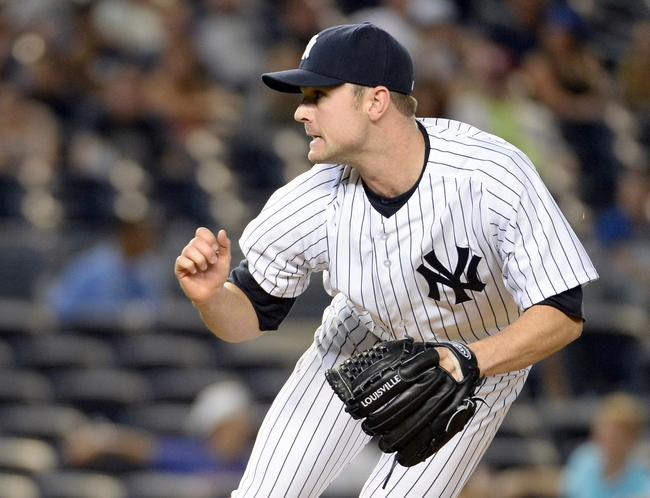Jun 18, 2014; Bronx, NY, USA; New York Yankees relief pitcher David Robertson throws a pitch against the Toronto Blue Jays in the 9th inning during the MLB baseball game at Yankee Stadium. Mandatory Credit: Robert Deutsch-USA TODAY Sports