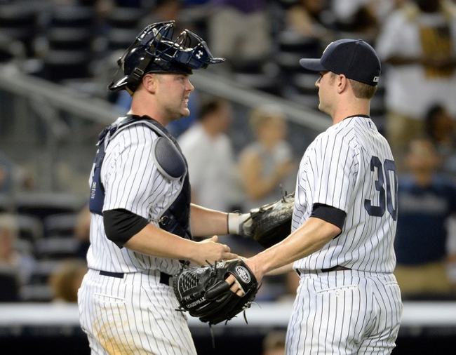 Jun 18, 2014; Bronx, NY, USA; New York Yankees relief pitcher David Robertson (30) shakes hands with catcher Brian McCann (left) after the MLB baseball game against the Toronto Blue Jays at Yankee Stadium. Mandatory Credit: Robert Deutsch-USA TODAY Sports