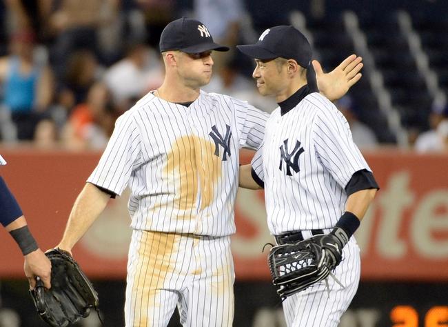 Jun 18, 2014; Bronx, NY, USA; New York Yankees outfielders Brett Gardner (left) and Ichiro Suzuki celebrate after the MLB baseball game against the Toronto Blue Jays at Yankee Stadium. Mandatory Credit: Robert Deutsch-USA TODAY Sports