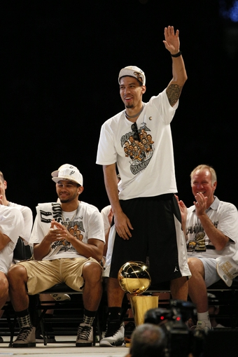 Jun 18, 2014; San Antonio, TX, USA; San Antonio Spurs guard Danny Green (4) waves to the crowd during NBA championship celebrations at Alamodome. Mandatory Credit: Soobum Im-USA TODAY Sports