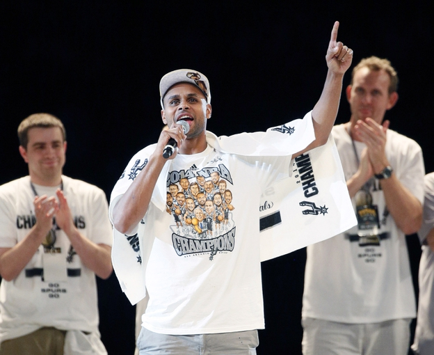 Jun 18, 2014; San Antonio, TX, USA; San Antonio Spurs guard Patrick Mills (8) speaks to the crowd during NBA championship celebrations at Alamodome. Mandatory Credit: Soobum Im-USA TODAY Sports