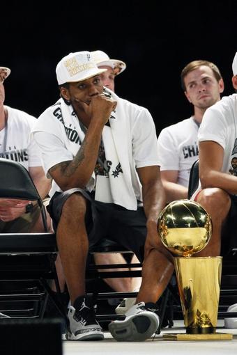 Jun 18, 2014; San Antonio, TX, USA; San Antonio Spurs forward Kawhi Leonard (2) during NBA championship celebrations at Alamodome. Mandatory Credit: Soobum Im-USA TODAY Sports