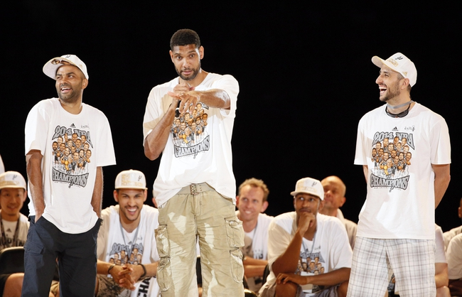 Jun 18, 2014; San Antonio, TX, USA; San Antonio Spurs forward Tim Duncan (middle) speaks as teammates Tony Parker (left) and Manu Ginobili (right) listen during NBA championship celebrations at Alamodome. Mandatory Credit: Soobum Im-USA TODAY Sports