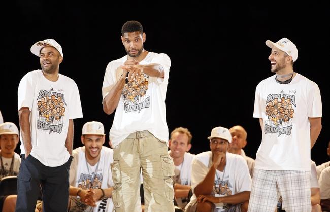 Jun 18, 2014; San Antonio, TX, USA; San Antonio Spurs forward Tim Duncan (middle) speaks as teammates Tony Parker (left) and Manu Ginobili (right) listen during NBA championship celebrations at Alamodome. Mandatory Credit: Soobum Im-USA TODAY Sports
