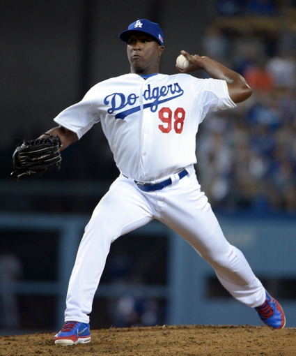 Sep 11, 2013; Los Angeles, CA, USA; Los Angeles Dodgers reliever Onelki Garcia (98) delivers a pitch against the Arizona Diamondbacks at Dodger Stadium in his MLB debut. The Diamondbacks defeated the Dodgers 4-1. Mandatory Credit: Kirby Lee-USA TODAY Sports
