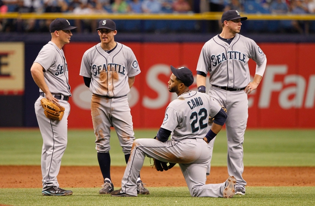 Jun 8, 2014; St. Petersburg, FL, USA; Seattle Mariners third baseman Kyle Seager (15), shortstop Brad Miller (5), second baseman Robinson Cano (22) and first baseman Justin Smoak (17) wait during a pitching change against the Tampa Bay Rays at Tropicana Field. Seattle Mariners defeated the Tampa Bay Rays 5-0. Mandatory Credit: Kim Klement-USA TODAY Sports