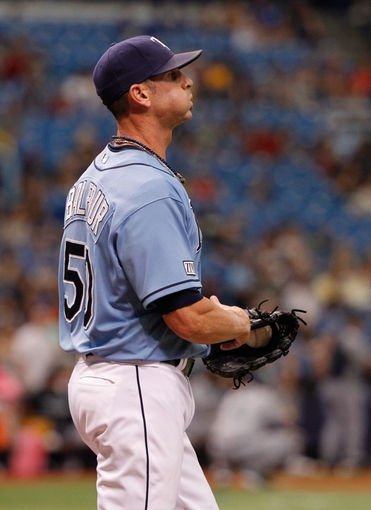 Jun 8, 2014; St. Petersburg, FL, USA; Tampa Bay Rays relief pitcher Grant Balfour (50) reacts after he gave up runs against the Seattle Mariners at Tropicana Field. Seattle Mariners defeated the Tampa Bay Rays 5-0. Mandatory Credit: Kim Klement-USA TODAY Sports