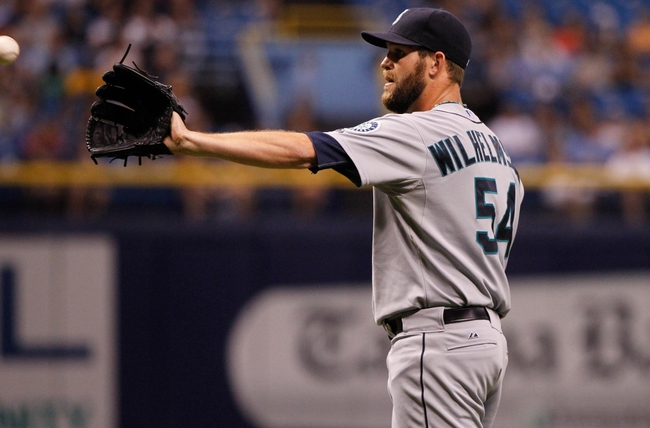 Jun 6, 2014; St. Petersburg, FL, USA; Seattle Mariners relief pitcher Tom Wilhelmsen (54) against the Tampa Bay Rays at Tropicana Field. Tampa Bay Rays defeated the Seattle Mariners 4-0. Mandatory Credit: Kim Klement-USA TODAY Sports
