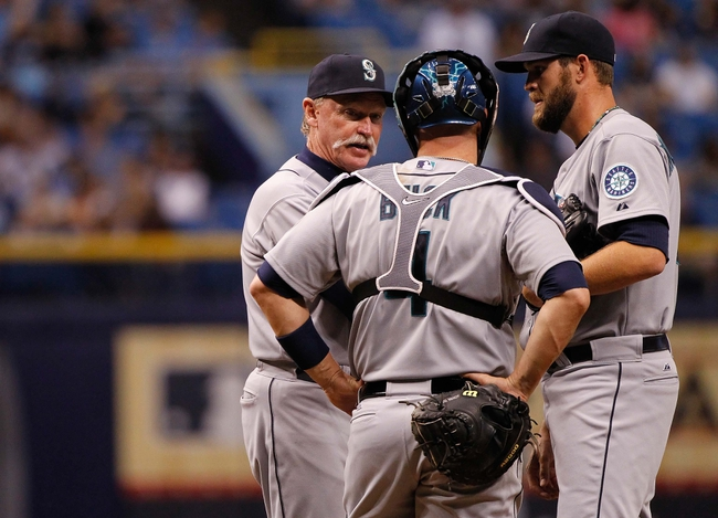 Jun 6, 2014; St. Petersburg, FL, USA; Seattle Mariners pitching coach Rick Waits (47) talks with catcher John Buck (4) and relief pitcher Tom Wilhelmsen (54) on the mound against the Tampa Bay Rays at Tropicana Field. Tampa Bay Rays defeated the Seattle Mariners 4-0. Mandatory Credit: Kim Klement-USA TODAY Sports