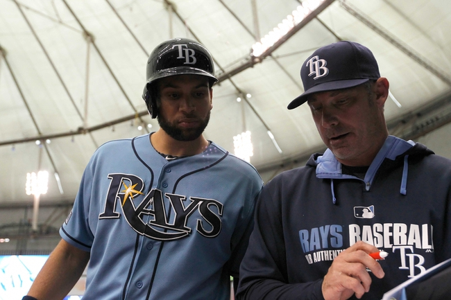 Jun 8, 2014; St. Petersburg, FL, USA; Tampa Bay Rays first baseman James Loney (21) talks with hitting coach Derek Shelton (16) at Tropicana Field. Seattle Mariners defeated the Tampa Bay Rays 5-0. Mandatory Credit: Kim Klement-USA TODAY Sports