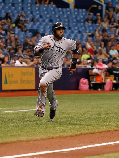 Jun 8, 2014; St. Petersburg, FL, USA; Seattle Mariners second baseman Robinson Cano (22) runs home against the Tampa Bay Rays at Tropicana Field. Seattle Mariners defeated the Tampa Bay Rays 5-0. Mandatory Credit: Kim Klement-USA TODAY Sports