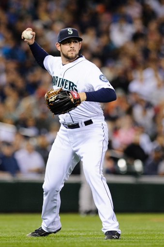 Jun 12, 2014; Seattle, WA, USA; Seattle Mariners relief pitcher Dominic Leone (52) throws the ball to first base during the game against the New York Yankees at Safeco Field. New York defeated Seattle 6-3. Mandatory Credit: Steven Bisig-USA TODAY Sports