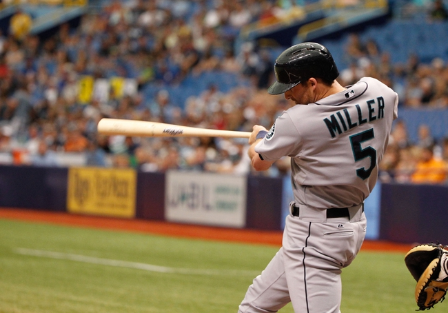 Jun 8, 2014; St. Petersburg, FL, USA; Seattle Mariners shortstop Brad Miller (5) at bat against the Tampa Bay Rays at Tropicana Field. Mandatory Credit: Kim Klement-USA TODAY Sports