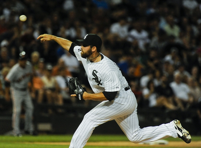 Jun 17, 2014; Chicago, IL, USA; Chicago White Sox relief pitcher Zach Putnam (57) pitches against the San Francisco Giants at U.S Cellular Field. Mandatory Credit: Matt Marton-USA TODAY Sports