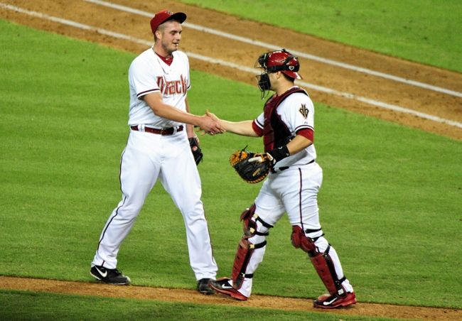 Jun 20, 2014; Phoenix, AZ, USA; Arizona Diamondbacks relief pitcher Addison Reed (43) celebrates with catcher Miguel Montero (26) after beating the Arizona Diamondbacks 4-1 at Chase Field. Mandatory Credit: Matt Kartozian-USA TODAY Sports