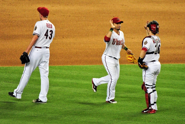 Jun 20, 2014; Phoenix, AZ, USA; Arizona Diamondbacks right fielder Gerardo Parra (8), catcher Miguel Montero (26) and relief pitcher Addison Reed (43) celebrate after beating the San Francisco Giants 4-1 at Chase Field. Mandatory Credit: Matt Kartozian-USA TODAY Sports