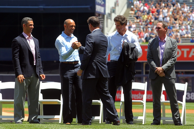 Jun 21, 2014; Bronx, NY, USA; New York Yankees former player Tino Martinez (center) greets (left to right) former teammates Jorge Posada and Mariano Rivera and Paul O'Neill and David Cone during a ceremony before a game against the Baltimore Orioles at Yankee Stadium. Mandatory Credit: Brad Penner-USA TODAY Sports