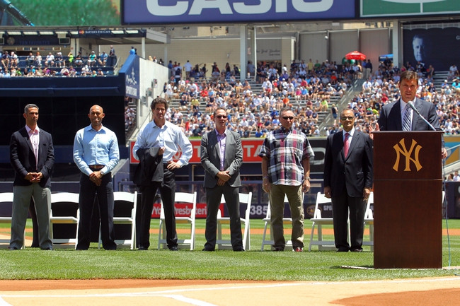 Jun 21, 2014; Bronx, NY, USA; New York Yankees former player Tino Martinez speaks in front of (from left) former Yankees Jorge Posada and Mariano Rivera and Paul O'Neill and David Cone and former trainer Gene Monahan and former manager Joe Torre during a ceremony before a game against the Baltimore Orioles at Yankee Stadium. Mandatory Credit: Brad Penner-USA TODAY Sports
