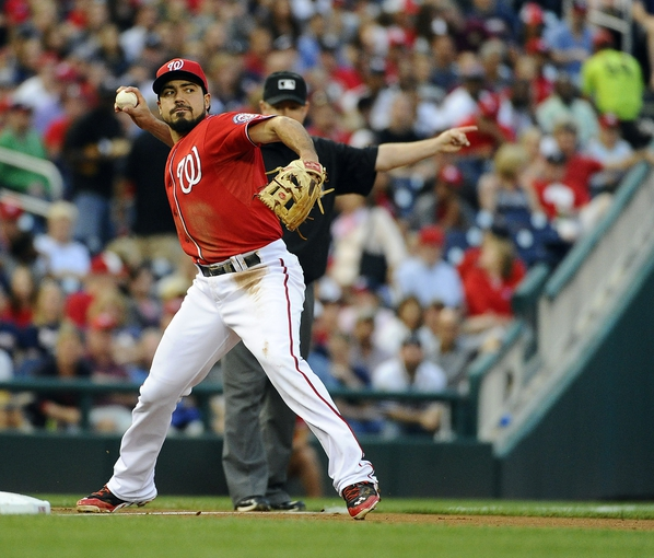 Jun 21, 2014; Washington, DC, USA; Washington Nationals third baseman Anthony Rendon (6) throws to first during the against the Atlanta Braves inning at Nationals Park. Mandatory Credit: Brad Mills-USA TODAY Sports