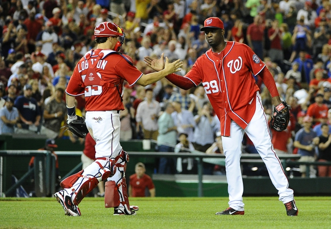 Jun 21, 2014; Washington, DC, USA; Washington Nationals relief pitcher Rafael Soriano (29) is congratulated by catcher Jose Lobaton (59) after earning a save against the Atlanta Braves  at Nationals Park. The Nationals won 3-0. Mandatory Credit: Brad Mills-USA TODAY Sports
