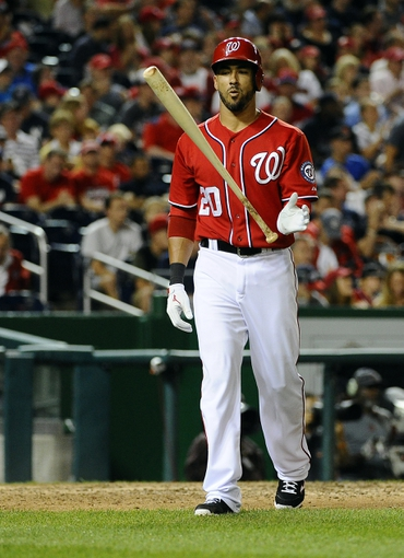Jun 21, 2014; Washington, DC, USA; Washington Nationals shortstop Ian Desmond (20) reacts after striking out against the Atlanta Braves during the eighth inning at Nationals Park. The Nationals won 3-0. Mandatory Credit: Brad Mills-USA TODAY Sports