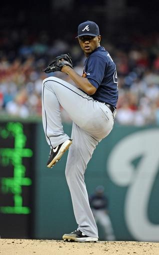 Jun 21, 2014; Washington, DC, USA; Atlanta Braves starting pitcher Julio Teheran (49) throws during the first inning against the Washington Nationals at Nationals Park. Mandatory Credit: Brad Mills-USA TODAY Sports