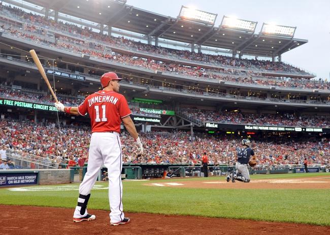 Jun 21, 2014; Washington, DC, USA; Washington Nationals left fielder Ryan Zimmerman (11) warms up  during the second inning against the Atlanta Braves at Nationals Park. The Nationals won 3-0. Mandatory Credit: Brad Mills-USA TODAY Sports
