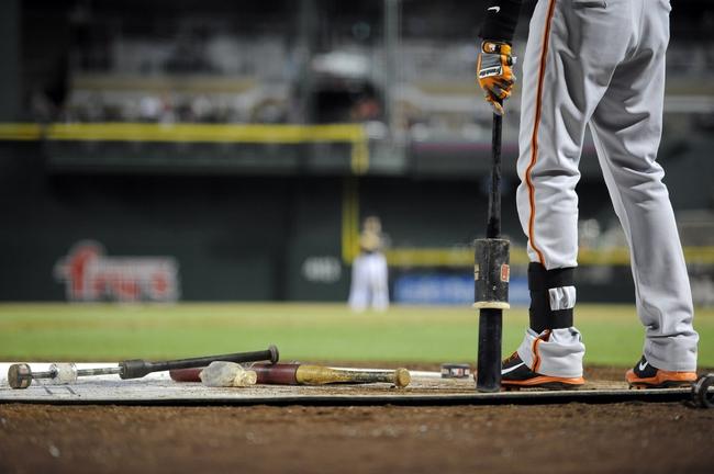 Jun 21, 2014; Phoenix, AZ, USA; San Francisco Giants third baseman Joaquin Arias (13) waits on deck against the Arizona Diamondbacks at Chase Field. Mandatory Credit: Joe Camporeale-USA TODAY Sports