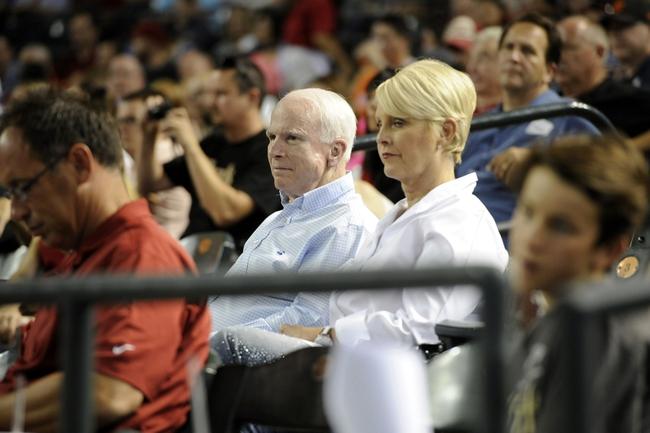 Jun 21, 2014; Phoenix, AZ, USA; United States senator John McCain and wife Cindy McCain attend the game between the Arizona Diamondbacks and the San Francisco Giants at Chase Field. Mandatory Credit: Joe Camporeale-USA TODAY Sports