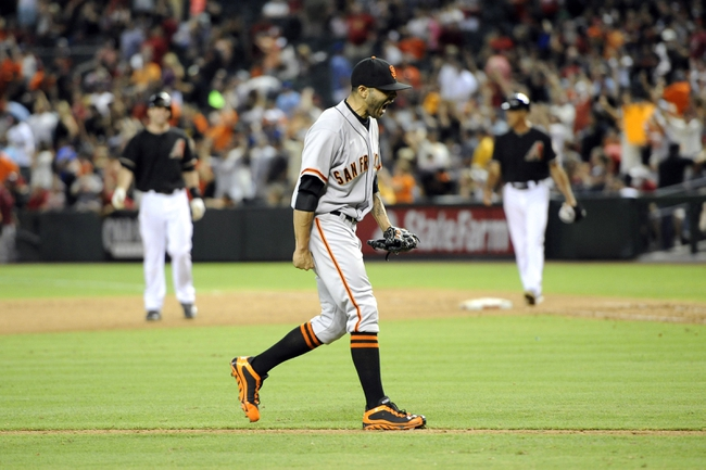 Jun 21, 2014; Phoenix, AZ, USA; San Francisco Giants relief pitcher Sergio Romo (54) reacts after the final out against the Arizona Diamondbacks in the ninth inning at Chase Field. The Giants won 6-4. Mandatory Credit: Joe Camporeale-USA TODAY Sports