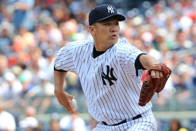 Jun 22, 2014; Bronx, NY, USA;  New York Yankees starting pitcher Masahiro Tanaka (19) pitches during the first inning against the Baltimore Orioles at Yankee Stadium. Mandatory Credit: Anthony Gruppuso-USA TODAY Sports