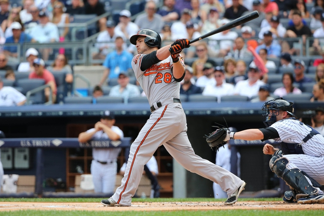 Jun 22, 2014; Bronx, NY, USA;  Baltimore Orioles first baseman Steve Pearce (28) singles to left during the first inning against the New York Yankees at Yankee Stadium. Mandatory Credit: Anthony Gruppuso-USA TODAY Sports