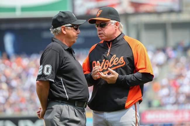 Jun 22, 2014; Bronx, NY, USA;  Baltimore Orioles manager Buck Showalter (26) asks umpire Tom Hallion (20) for a video review on a play at third during the first inning against the New York Yankees at Yankee Stadium. Mandatory Credit: Anthony Gruppuso-USA TODAY Sports