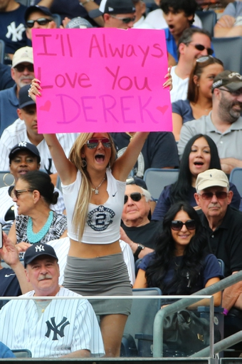 Jun 22, 2014; Bronx, NY, USA;  Fan displays a sign for New York Yankees shortstop Derek Jeter (2) during the game against the Baltimore Orioles at Yankee Stadium. Mandatory Credit: Anthony Gruppuso-USA TODAY Sports