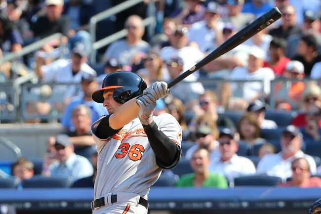 Jun 22, 2014; Bronx, NY, USA;  Baltimore Orioles catcher Caleb Joseph (36) hits a sacrifice fly allowing a runner to score during the seventh inning against the New York Yankees at Yankee Stadium. Baltimore Orioles won 8-0. Mandatory Credit: Anthony Gruppuso-USA TODAY Sports