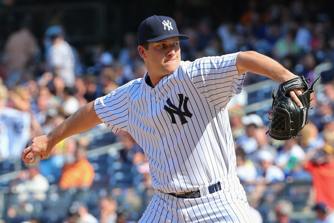 Jun 22, 2014; Bronx, NY, USA;  New York Yankees relief pitcher Adam Warren (43) delivers a pitch during the eighth inning against the Baltimore Orioles at Yankee Stadium. Baltimore Orioles won 8-0. Mandatory Credit: Anthony Gruppuso-USA TODAY Sports