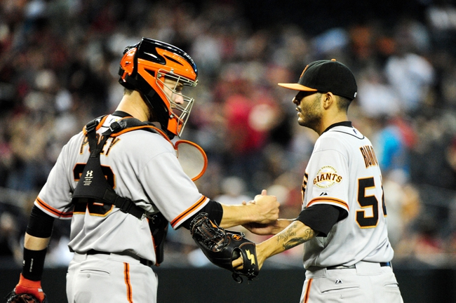 Jun 22, 2014; Phoenix, AZ, USA; San Francisco Giants relief pitcher Sergio Romo (54) celebrates with catcher Buster Posey (28) after beating the Arizona Diamondbacks 4-1 at Chase Field. Mandatory Credit: Matt Kartozian-USA TODAY Sports