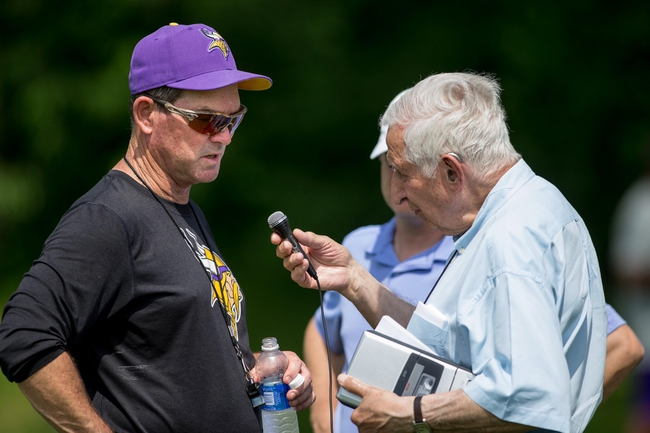 Jun 17, 2014; Eden Prairie, MN, USA; Minnesota Vikings head coach Mike Zimmer speaks with StarTribune columnist Sid Hartman after practice at Winter Park. Mandatory Credit: Bruce Kluckhohn-USA TODAY Sports