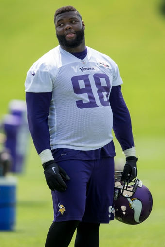 Jun 17, 2014; Eden Prairie, MN, USA; Minnesota Vikings defensive tackle Linval Joseph (98) rests at practice at Winter Park. Mandatory Credit: Bruce Kluckhohn-USA TODAY Sports