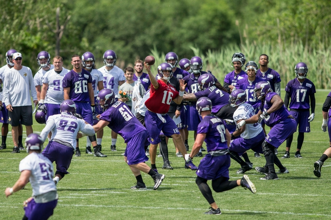 Jun 17, 2014; Eden Prairie, MN, USA; Minnesota Vikings quarterback Matt Cassel (16) throws at practice at Winter Park. Mandatory Credit: Bruce Kluckhohn-USA TODAY Sports