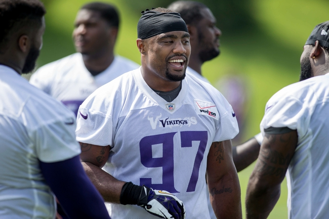 Jun 17, 2014; Eden Prairie, MN, USA; Minnesota Vikings defensive end Everson Griffen (97) talks with a teammate at practice at Winter Park. Mandatory Credit: Bruce Kluckhohn-USA TODAY Sports