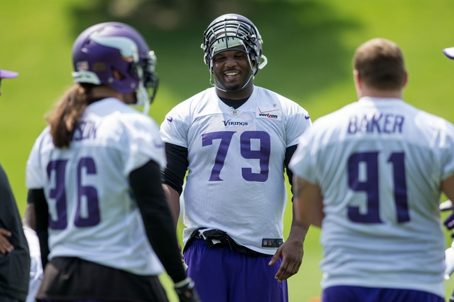 Jun 17, 2014; Eden Prairie, MN, USA; Minnesota Vikings defensive tackle Kheeston Randall (79) talks with a teammate at practice at Winter Park. Mandatory Credit: Bruce Kluckhohn-USA TODAY Sports