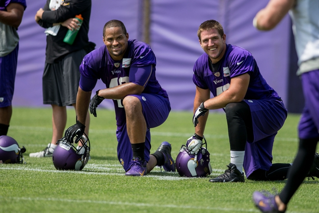 Jun 17, 2014; Eden Prairie, MN, USA; Minnesota Vikings fullback Jerome Felton (42) and fullback Zach Line (48) rest at practice at Winter Park. Mandatory Credit: Bruce Kluckhohn-USA TODAY Sports