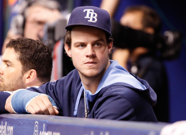 Jun 17, 2014; St. Petersburg, FL, USA; Tampa Bay Rays right fielder Wil Myers (9) in the dugout against the Baltimore Orioles at Tropicana Field. Baltimore Orioles defeated the Tampa Bay Rays 7-5. Mandatory Credit: Kim Klement-USA TODAY Sports
