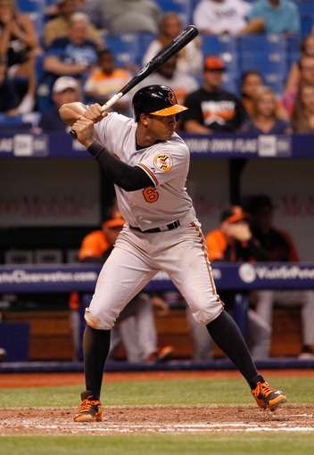 Jun 17, 2014; St. Petersburg, FL, USA; Baltimore Orioles second baseman Jonathan Schoop (6) at bat against the Tampa Bay Rays at Tropicana Field. Mandatory Credit: Kim Klement-USA TODAY Sports